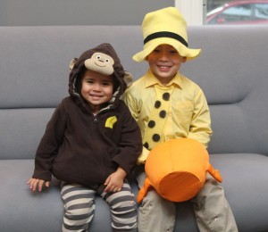 Partner Lina Bankert's kids as Curious George and the Man in the Yellow Hat