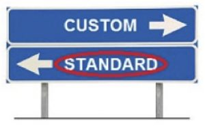 "road signs with word ""Custom"" and an arrow pointing to the left, and below it a sign reading ""Standard"" and pointing to the right, word standard is circled in red"