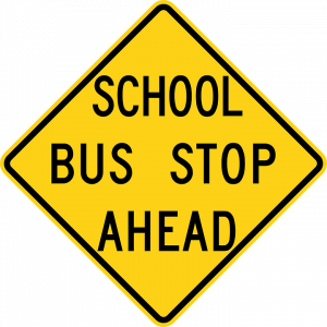 "yellow sign reading ""SCHOOL BUS STOP AHEAD"""