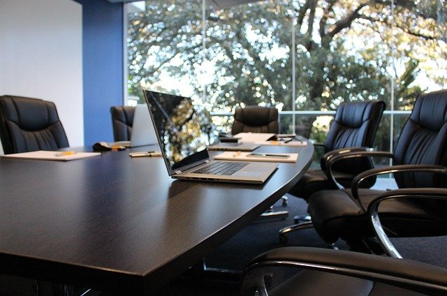empty office boardroom with laptop on meeting table